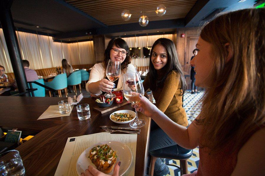 Women enjoying wine at Root Restaurant and Wine Bar