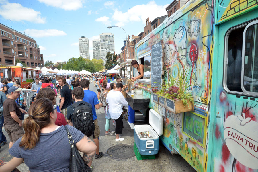 Visitors enjoying the food trucks at GreenFest Philly