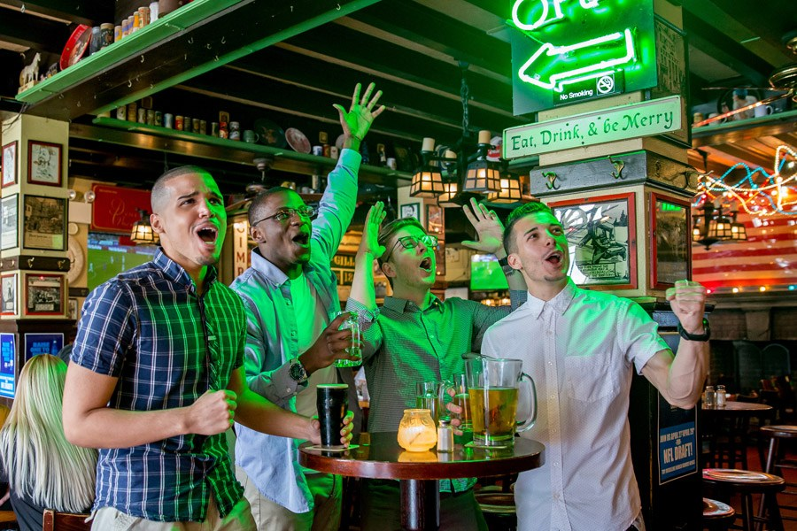 fans cheering on a sports team at mcgillin's in philadelphia