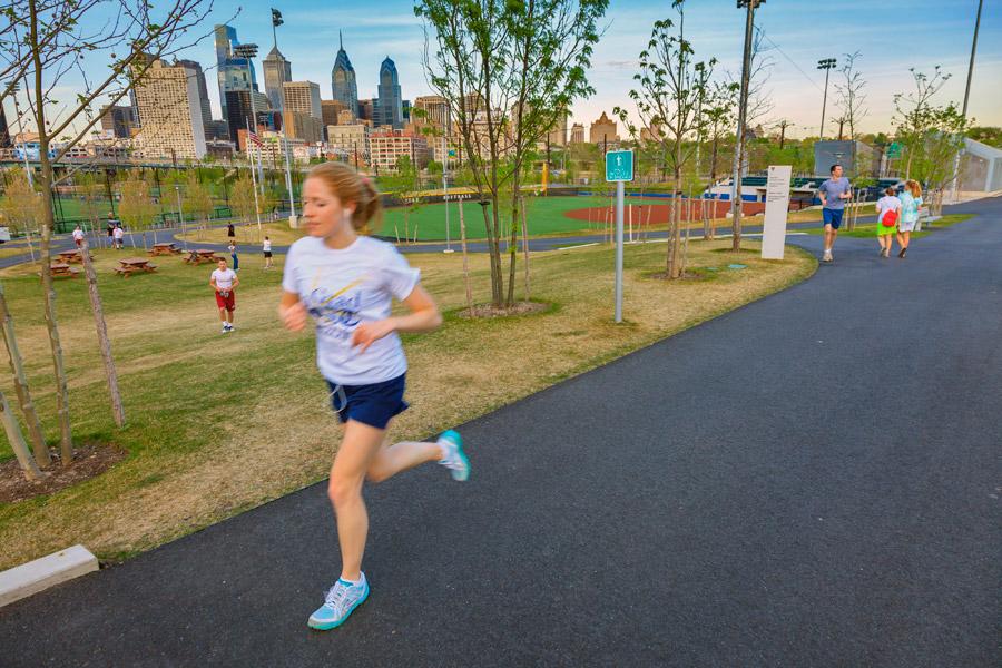 A runner along the track at Penn Park