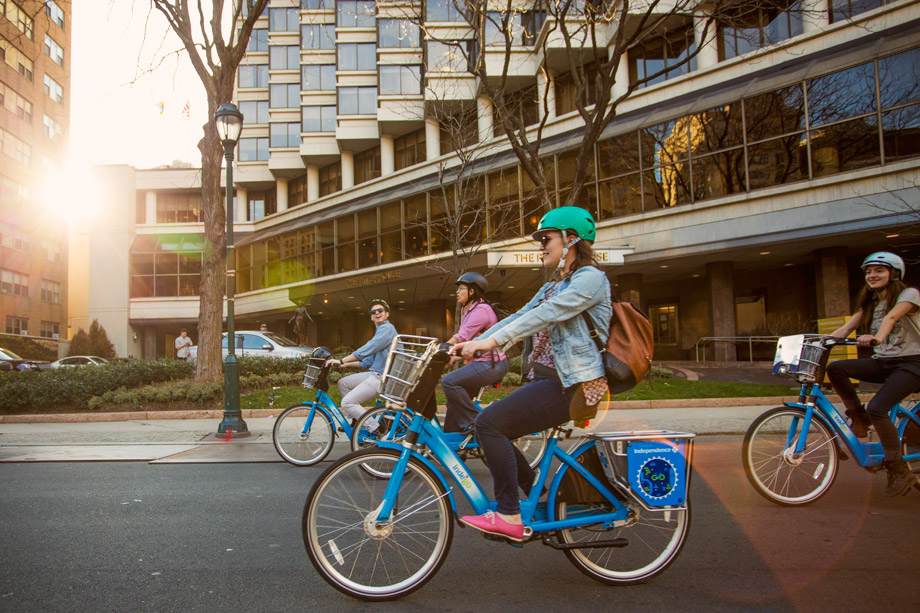 people riding indego bikes in philadelphia