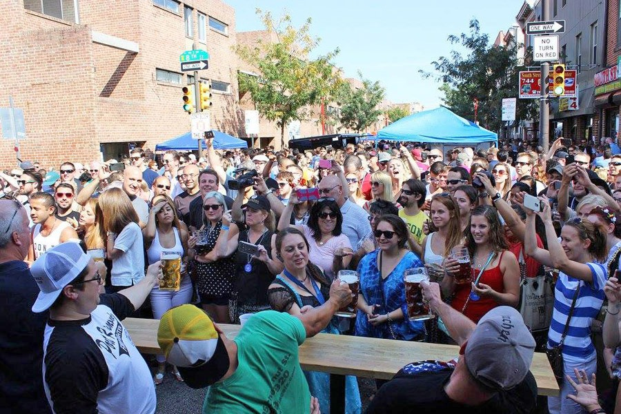 Brauhaus Schmitz's giant block party on South Street draws hundreds of people.