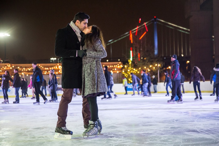 A couple skating at Blue Cross RiverRink WInterfest