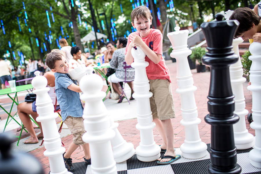 kids playing giant chess at spruce street harbor park
